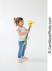 Little girl standing isolated over white background.
