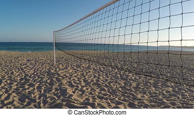 Volleyball net on beach in summer in Albufeira. - Volleyball...