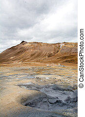 Mudpot in the Namafjall geothermal area, Iceland - area...