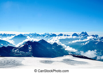 Snow covered Elbrus mountains at winter sunny day