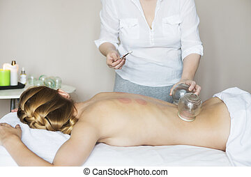 Young woman getting treatment at medical clinic
