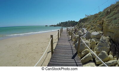 Video passage, on a wooden bridge on beach Olhos de Agua. -...