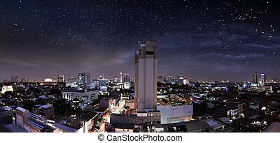 Portrait of modern jakarta city with skyscrapers and star on sky