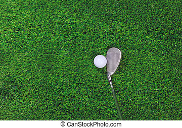 Golf ball and iron club on grass - Photo of a Golf ball and...