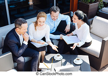 Nice professional businesspeople having a meeting -...