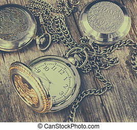 Corman old clock - old pocket watch on an old wooden...