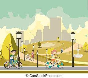 Happy little kids in bikes in park