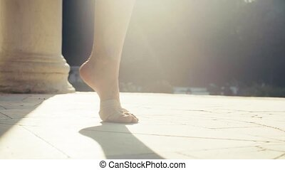 Bare feet of a woman dancing on a stone floor - Close up...