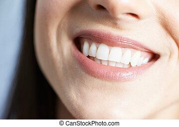 Close Up Of Woman With Beautiful Teeth And A Perfect Smile