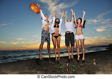 beach party - happy young friends group have fun and...
