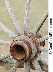 Old Wagon Wheel - Old wooden wagon wheel with rusty hub