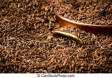 caraway seed full frame with copper saucepan
