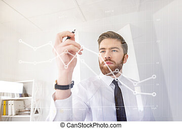 Young concentrated business man drawing chart on the virtual screen
