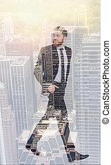 Full length double exposure of businessman - Full length...