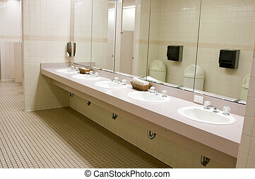 Public Bathroom - Perspective shot of a countertop with five...