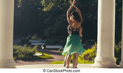 Young couple dancing in the park in summer