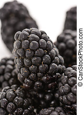 ripe blackberries - closeup of a pile of appetizing ripe...
