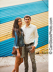 Beautiful young couple on the city background.