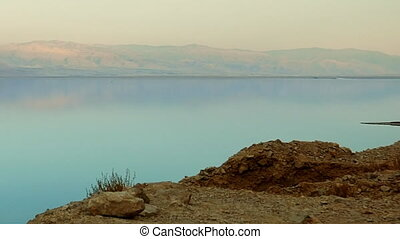 Mountain lake sunset panoramic shot. The water in the desert...