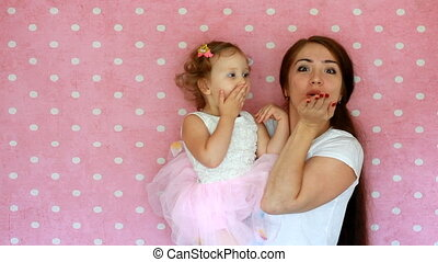 Mom and daughter . Mother and child smilling send air kisses