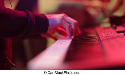 The musician plays the piano on the concert