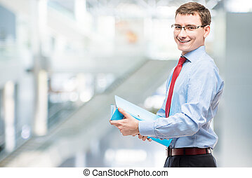 Happy chief accountant with a folder of documents