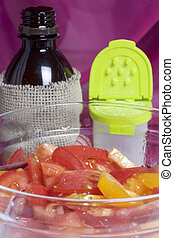 Vegetables: tomatoes, onions are sliced for salad and placed...