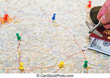 Going to the vacation trip by plane idea - Big road map in...
