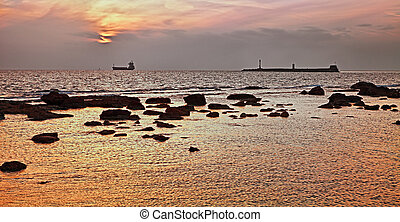 Leghorn (Livorno), Tuscany, Italy: seascape at sunset of the...