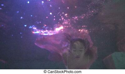 Beautiful woman underwater - Beautiful woman in white bikini...