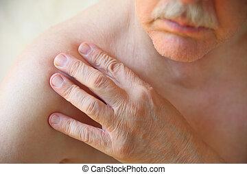 Older man has ache in shoulder