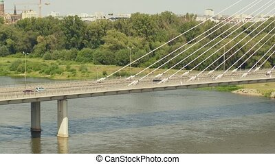 Aerial shot of the modern guyed bridge over the Vistula...