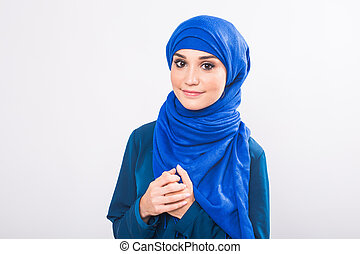 beautiful asian muslim woman model posing on white background in studio