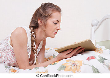 Attractive blond girl with hairdress reading