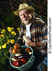 grandpa with harvest - Smiling senior man with his harvest...
