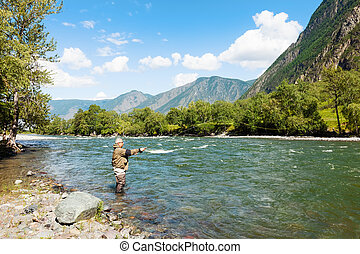 Fishing by flyfishing on the river. Russia Siberia. River...
