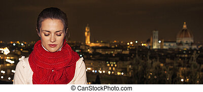 pensive young woman in front of panoramic view of Florence -...
