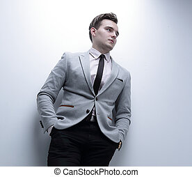 closeup of a young man in a business suit. - business...