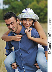 happy young couple have romantic time outdoor while smiling...