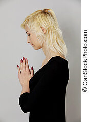 Praying to Lord - The portrait of woman praying with hands...