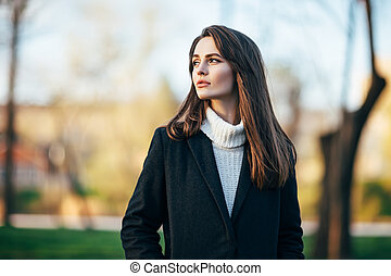 Beautiful woman portrait in the park at sunset time -...