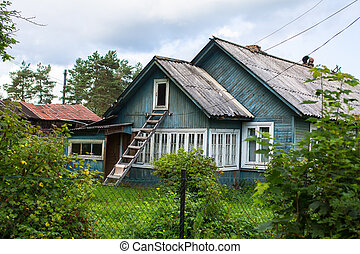 A typical residential wooden house in settlement in...