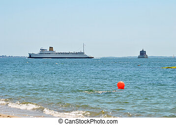 Cruise Ship Passing a Lighthouse in the United States
