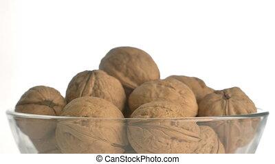 The nut walnut rotates on the turntable. - Nuts walnut turn...