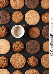 Various cookies and coffee - Cup of coffee among pattern of...