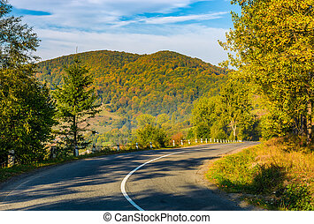 countryside road in mountains - countryside road through the...