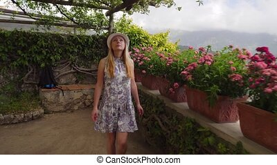 young blonde woman walking in Ravello at Italy - young woman...