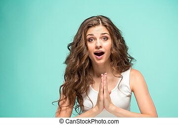 Portrait of young woman with shocked facial expression - The...