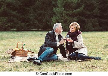 Smiling couple holding wine glasses