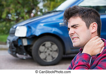 Male Motorist Suffering From Whiplash After Car Accident